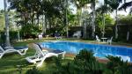 Delightful garden setting around the pool/spa/ barbecue hut.